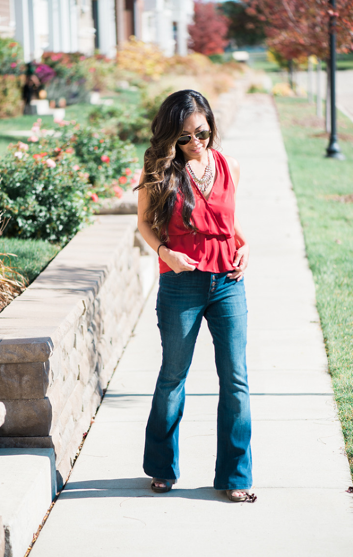 red top blue bellbottom jeans