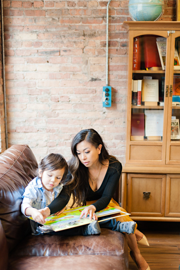 mom reading to toddler boy son